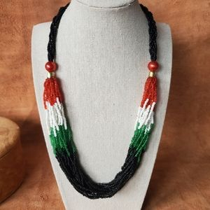 Red, white, green and black seed bead necklace